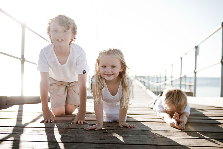 Three siblings at the beach - How to get the best family photos at the beach