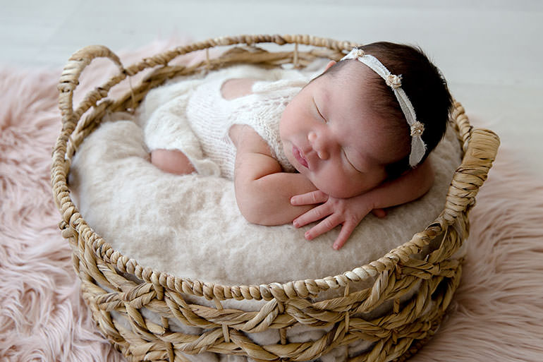 Baby girl in neutral natural newborn photography outfit