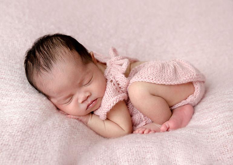 Newborn baby in pink - newborn photos
