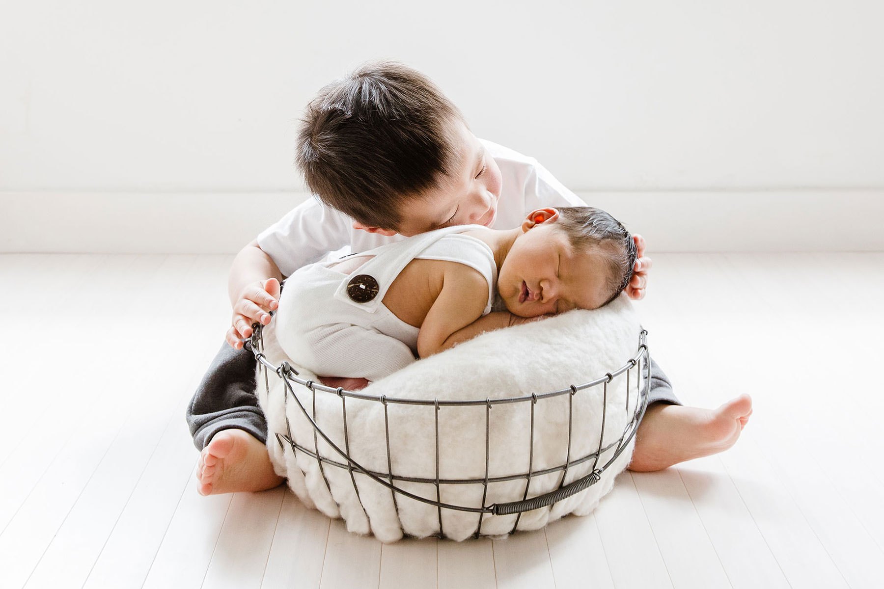 Newborn baby with toddler brother - in studio Melbourne Newborn Photography.